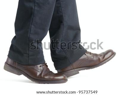 shoe and leg of a businessman caution step