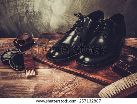 Shoe care accessories on a wooden table