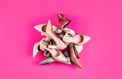 Shoe for women. Fashionable women shoes isolated on pink background. View from above.