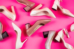 Shoe for women. Stylish classic women leather shoe. High heel women shoes on red background. Beauty and fashion concept. Fashionable women shoes isolated on pink background. View from above.