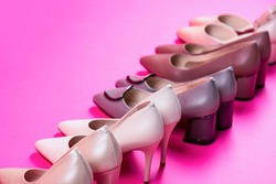 Shoe for women. Stylish classic women leather shoe. High heel women shoes on red background. Beauty and fashion concept. Fashionable women shoes isolated on pink background.