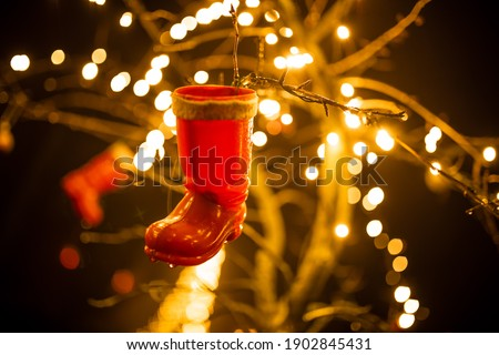 shoe hangs at Christmas on tree with fairy lights in background Photo stock ©