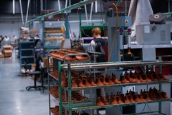 Shoe making process in footwear handmade  factory. Pandemic covid-19 virus.