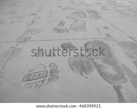 shoe prints on the floor white...