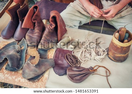 Shoemaker artisan at work. Vintage master workshop for the production of shoes. Repair boots in the old days.