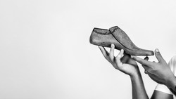 Shoemaker holding wooden footwear. Copy space. Man hands holding last shoe. New idea for start up. Modelling shoes business.