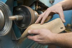 Shoemaker is repairing boot-tree