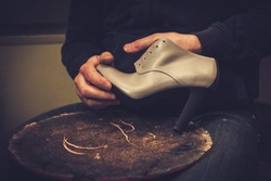 Shoemaker performs shoes in the studio craft.