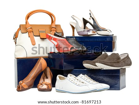 Shoes and handbag on boxes over white