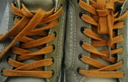 Shoes and orange shoelaces in closeup