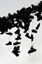 Shoes and sneakers above the street