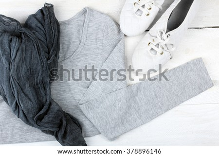 shoes and t shirt on a wooden table #378896146