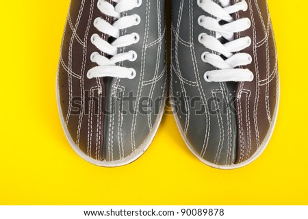 shoes for bowling on a yellow background. top view