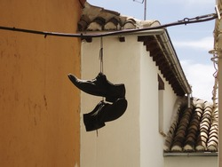 Shoes hanging from a cable in the street