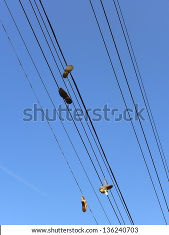 Shoes hanging from power lines are said to be gang symbols or the stuff of urban legends