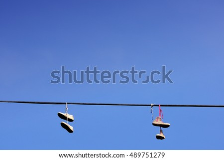 shoes hanging on a string...