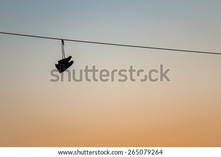 Shoes hanging on a telephone wire