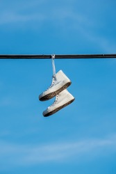 Shoes Hanging on a Wire with blue sky