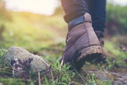 Shoes Man walking on a forest path in autumn and Lifestyle hiking concept. Travel hiking.