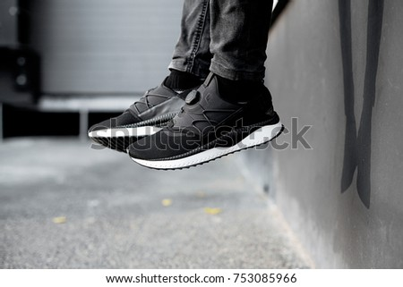 shoes on legs, city sneakers urban background