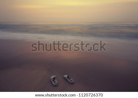 02979055b2de shoes on sand beach blue summer sky background.selective focus.