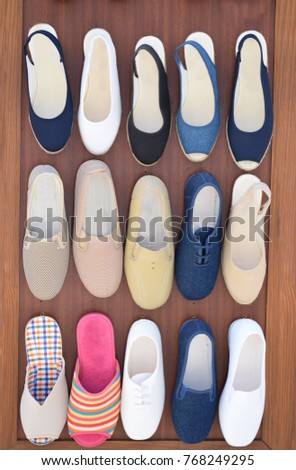 Shoes, shoes, shoes, fifteen shoes on a board #768249295