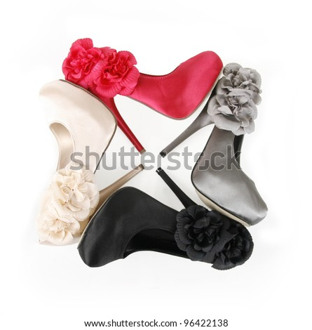shoes with flowers in square composition isolated on white