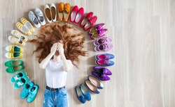 shoes women various styles on a wooden floor - lifestyles. A woman chooses her shoes.