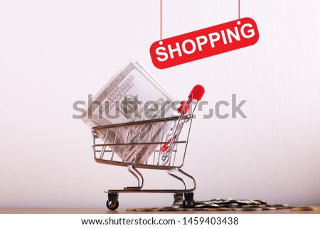 Shooping word concept with trolly and ud dollar