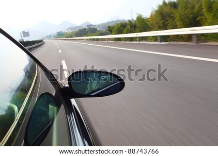 shoot from the window of rush car,motion blur road