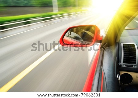 shoot from the window of rush car,motion blur steet - stock photo