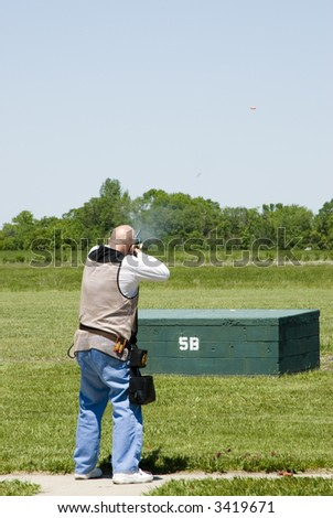 shooting clay pigeons at a trap shoot range
