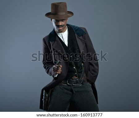 Shooting retro Afro america western cowboy man with mustache. Wearing brown hat. Cool tough guy.
