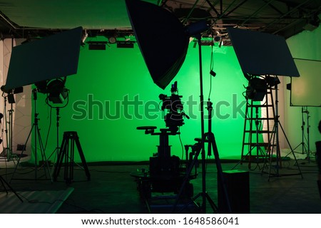 Photo of  Shooting studio with professional equipment and green screen