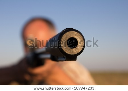 shooting with a gun on the nature