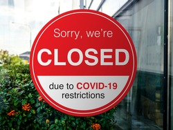 Shop, company, shopping centre closed due to COVID-19 or Coronavirus outbreak lockdown, Temporarily closed sign of coronavirus news. Information warning sign about quarantine measures in public places