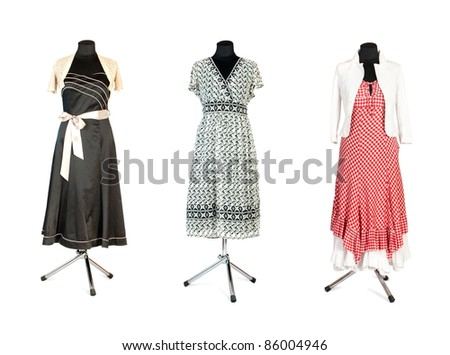 Shop Mannequin wearing three Dresses  isolated with clipping path
