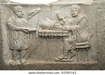 Shop moneychangers. The Roman bas-relief. Ancient financial transactions