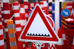 Shop of warning and restrictive road signs. Sign warning about a road blocker with spikes.