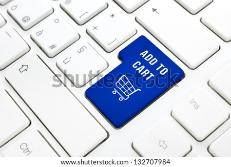 Shop on line add to cart business concept, Blue shopping cart button or key on white keyboard photography.