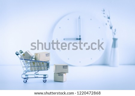Shop online, ecommerce / retail commerce concept : Box or cartons in a trolley or shopping cart on a seller working desk / office table, depicts new lifestyle customers buy products via online store. #1220472868