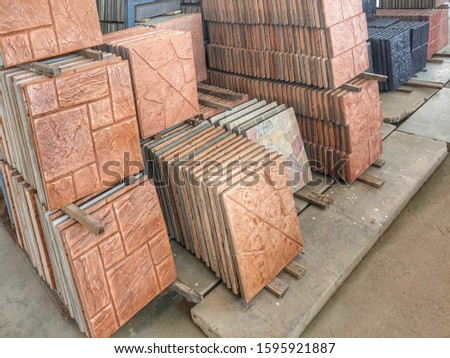 Shop sells exterior floor tiles are arranged in groups according to patterns for customers to choose conveniently. The patterned tiles imitate the nature of the stone