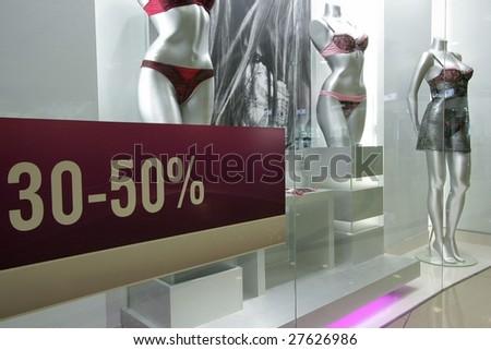 "Shop show-window. A dummy. An inscription: ""discounts of 30-50 %"""
