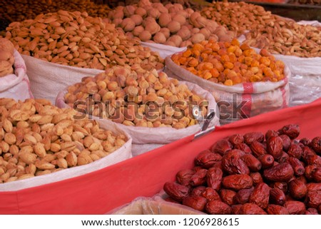 Shop stall in a market, offering wholesales varieties of beans and dried fruit, product from desert area. #1206928615