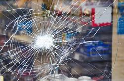 Shop window display with broken glass