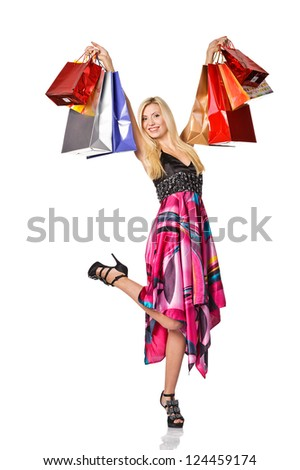 Shopaholic. picture of lovely woman with shopping bags. Isolated