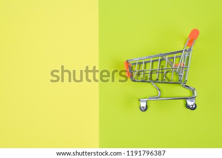 Shopaholic shopper memo text concept. Close up top above overhead high angle close up view photo of one single shine  pushcart isolated divided juicy saturated green yellow color background copy space #1191796387