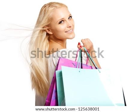 Shopaholic with shopping bags isolated on white background