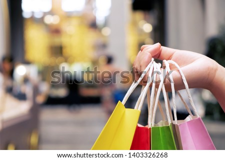 Shopaholic woman with shopping bags, buying a lot of fashion clothes.