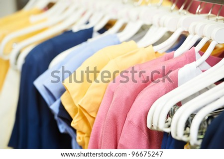 shoping sale background theme. clothes on hanger in shop